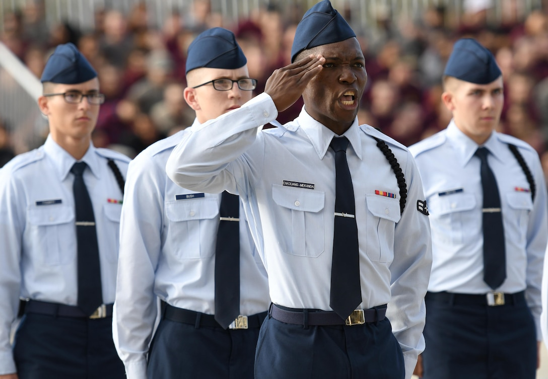 Airman 1st Class Michael Enkouang-Mekanda, 336th Training Squadron regulation drill team drillmaster, requests permission to enter the field of regulation drill competition during the 81st Training Group drill down at Keesler Air Force Base, Miss. Nov. 3, 2017. Airmen from the 81st TRG competed in the final quarterly open ranks inspection, regulation drill routine and freestyle drill routine. (U.S. Air Force photo by Kemberly Groue)