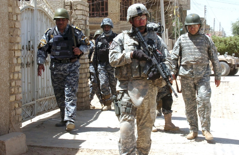 Army 1st Sgt. Henning Jensen, first sergeant of Headquarters Company, 1st Battalion, 1st Security Force Assistance Brigade, leads a foot patrol with the National Police Transition Team in eastern Baghdad in 2008.