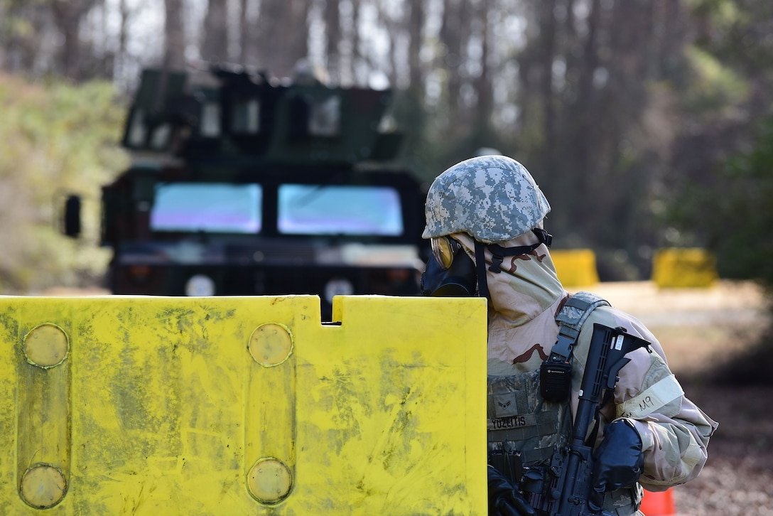 Airman 1st Class Andrew Yuzeitis, 4th Security Forces Squadron, takes cover behind a barrier during exercise Thunderdome 18-01, Jan. 11, 2018, at Seymour Johnson Air Force Base, North Carolina. Thunderdome is designed to keep Airmen in a warrior mindset and sharpen tactics, techniques and procedures to prevent unnecessary loss of life or injury in the event of a real-world incident. (U.S. Air Force photo by Airman 1st Class Kenneth Boyton)