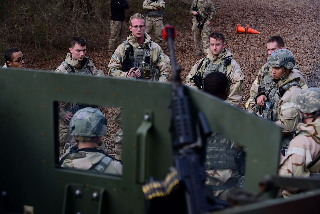 Airmen from the 4th Security Forces Squadron participate in a group briefing after a simulated attack during exercise Thunderdome 18-01, Jan. 11, 2018, at Seymour Johnson Air Force Base, North Carolina. Defenders of the 4th SFS immediately followed established procedures to respond to and neutralize the simulated threat. (U.S. Air Force photo by Airman 1st Class Kenneth Boyton)