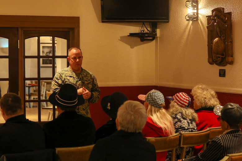 Lt. Col. Larry Warfield, assistant chief of staff, Marine Corps Community Services, speaks during a dedication ceremony for a sculpture by Claudio D'Augustino at the Officers' Club aboard the Marine Corps Air Ground Combat Center, Twentynine Palms, Calif., Jan. 9, 2018. The sculpture was donated to the Combat Center during the ceremony to express D'Augustino's appreciation for members of the armed services. (U.S. Marine Corps photo by Lance Cpl. Isaac Cantrell)