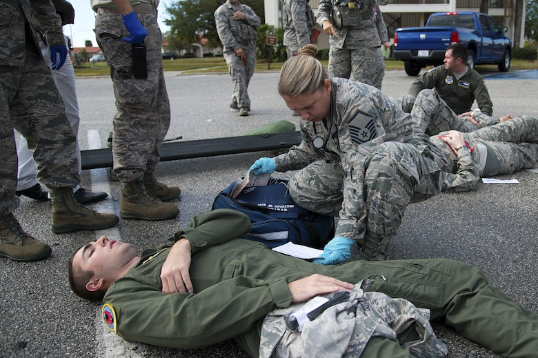 U.S. Air Force Senior Airman Jesse Barber, a boom operator assigned to the 50th Air Refueling Squadron, receives medical treatment for a simulated gunshot wound to the leg during an active shooter exercise at MacDill Air Force Base, Fla., Jan. 9, 2017. The exercise was an opportunity for medical first responders to train on initial care tactics.