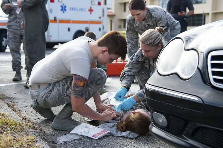 U.S. Air Force Airman 1st Class Stephanie Smith, an aviation resource manager assigned to the 6th Operations Support Squadron, receives medical treatment for a simulated gunshot wound during an active shooter exercise at MacDill Air Force Base, Fla., Jan. 9, 2017. The exercise was a way for the participating teams to practice effective teamwork and communication during a frantic situation.
