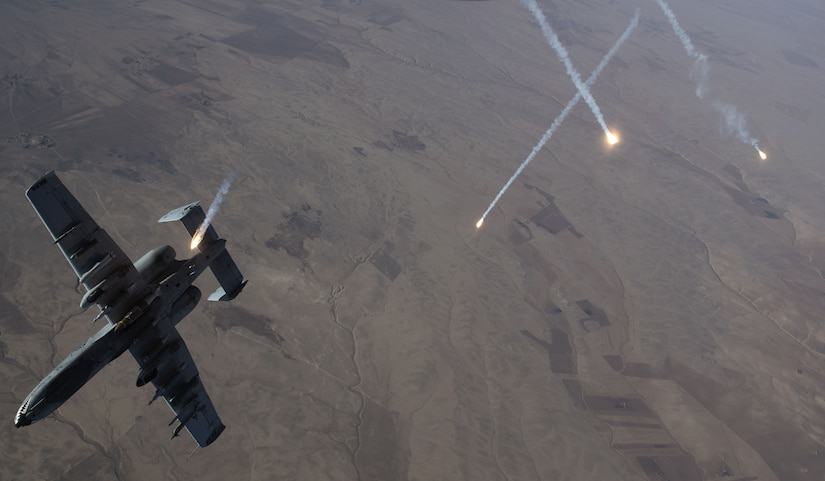 Countermeasures streak through the sky as an Air Force A-10 Thunderbolt II assigned to the 74th Expeditionary Fighter Squadron departs after refueling from a KC-135 Stratotanker over Syria.