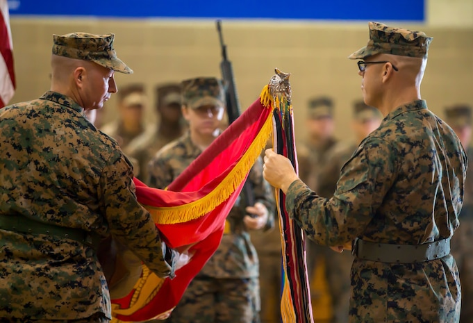 U.S. Marines with 11th Marine Regiment rededicate the regimental ribbons during a centennial ceremony at Marine Corps Base Camp Pendleton, Calif., Jan. 9, 2018.