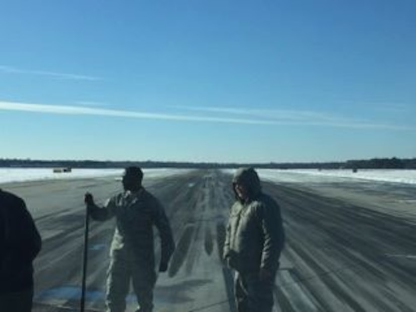 Joint Base Charleston personnel working to clear the airfield's runways Jan. 5-6 after historic winter storm Grayson dumped up to 6 inches of snow on the installation Jan. 3, 2018.