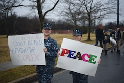 U.S. Navy hold signs in March