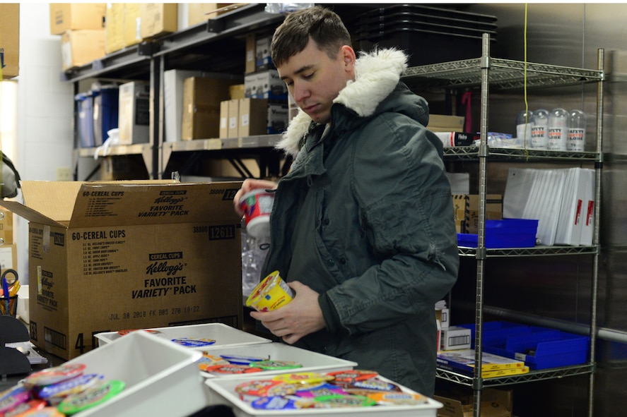 Airman 1st Class Austin Wetuski, 341st Force Support Squadron accountant and store clerk, separates cereal bowls to be sent out to individual missile alert facilities Jan. 12, 2018, at Malmstrom Air Force Base, Mont.