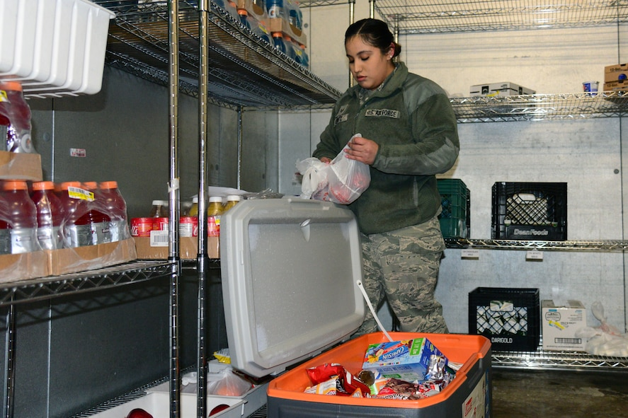 Senior Airman Alyssa Gantt, 341st Force Support Squadron accountant and store clerk, fills up a cooler Jan. 12, 2018, at Malmstrom Air Force Base, Mont.