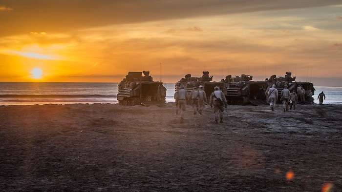 U.S. Marines with 1st Combat Engineer Battalion (CEB), 1st Marine Division, walk to their assault amphibious vehicles before a simulated amphibious breach in support of exercise Steel Knight 2018 at Marine Corps Base Camp Pendleton, Calif., Dec. 3, 2017.