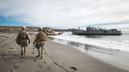 U.S. Marines with 1st Combat Engineer Battalion, 1st Marine Division, observe a beach after a simulated amphibious breach in support of exercise Steel Knight 2018 at San Clemente Island, Calif., Dec. 9, 2017.