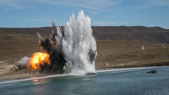 A U.S. Marine Corps amphibious assault vehicle with 1st Combat Engineer Battalion, 1st Marine Division, fires a mine clearing line charge during a simulated amphibious breach in support of exercise Steel Knight 2018 at San Clemente Island, Calif., Dec. 9, 2017.