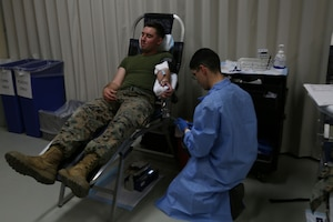 CAMP FOSTER, OKINAWA, Japan – Lance Cpl. Jarrid Young donates blood Jan. 11 at the Single Marine Program blood drive aboard Camp Foster, Okinawa, Japan.