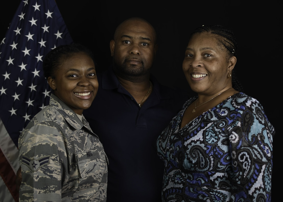 Airman 1st Class Paris Mayo, 380th Expeditionary Communications Squadron, client support technician, and her grandparents [Kelly and Areon Robinson] pose for a family portrait at Al Dhafra Air Base, United Arab Emirates Jan. 9, 2018. The Mayo and Robertson family have spent more than 50 years serving overseas. (U.S. Air National Guard photo illustration by Staff Sgt. Colton Elliott) (this image was created using blurring and cloning techniques)
