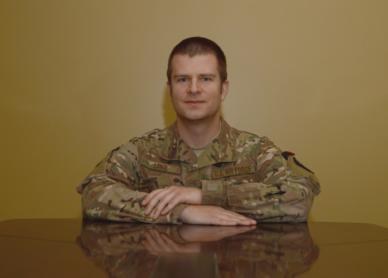 Capt. John-Charles Laws, U.S. Forces Afghanistan National Security Justice Development Directive legal advisor, poses for a photo Jan. 4, 2018 at Bagram Airfield, Afghanistan.