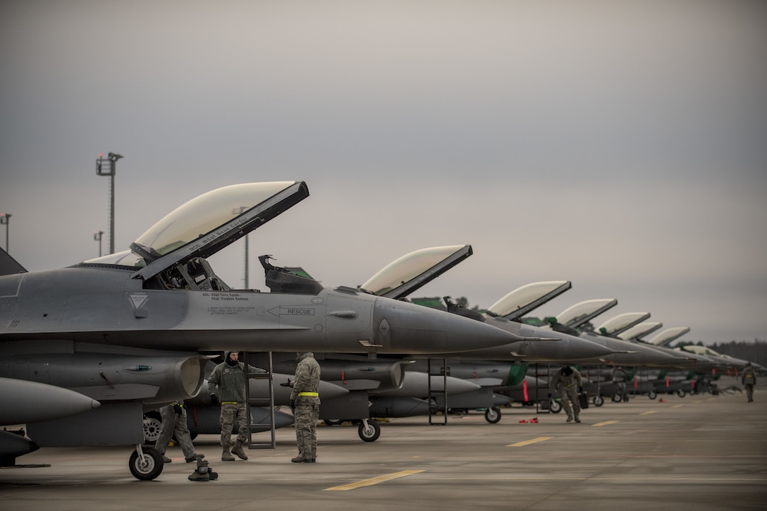 F-16s from the 180th Fighter Wing, Ohio Air National Guard, park on the ramp at Amari Air Base, Estonia, after arriving January 14th, 2018. The twelve F-16s are part of a theater security package that highlights the U.S.'s ability to deploy fighter aircraft in support of our partners and allies in the European theater, and around the world. (DoD photo by MC3 Cody Hendrix)