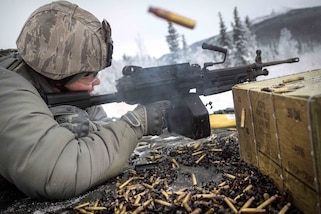 Airmen fire at targets with squad automatic weapons during a machine gun qualification course at Joint Base Elmendorf-Richardson, Alaska, Jan. 10, 2018. Air Force photos by Justin Connaher