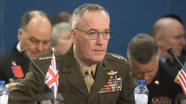 The chairman of the Joint Chiefs of Staff attends a NATO meeting.