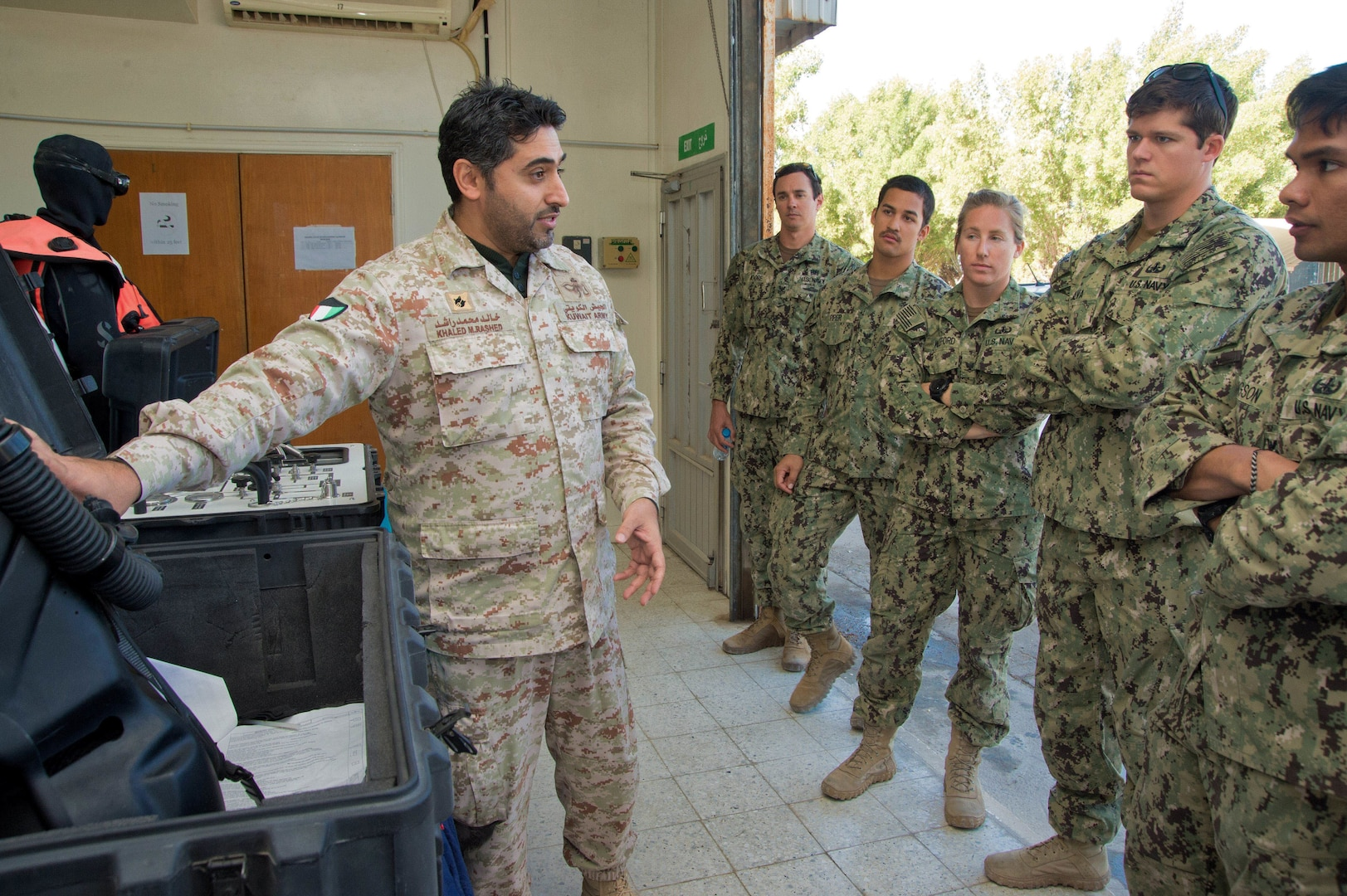 180107-N-XE158-0094 Mohammed Al-Ahmad Naval Base, KUWAIT (Jan. 7, 2018) U.S. Navy explosive ordnance disposal technicians, assigned to Commander, Task Group 56.1, and Kuwait Naval Force explosive ordnance disposal technicians participate in complete range autonomous breathing equipment training as part of exercise Eager Response 18. Eager Response 18 is a bilateral explosive ordnance disposal military exercise between the State of Kuwait and the United States. The exercise fortifies military-to-military relationships between the Kuwait Naval Force and U.S. Navy, advances the operational capabilities of Kuwaiti and U.S. forces to operate in the maritime domain, and enhances interoperability and warfighting readiness. (U.S. Navy photo by Mass Communication Specialist 1st Class Louis Rojas/Released)