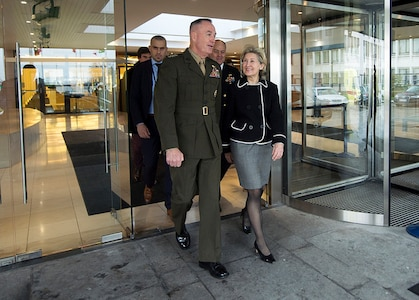 Marine Corps Gen. Joe Dunford, chairman of the Joint Chiefs of Staff, meets with Ambassador Kay Bailey Hutchison, the U.S. Ambassador to NATO, ahead of the 178th Military Committee in Chiefs of Defense Session at NATO Headquarters, in Brussels, Belgium's capital city, Jan. 15, 2018. DoD photo by Navy Petty Officer 1st Class Dominique A. Pineiro