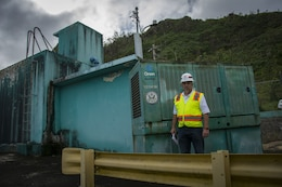 Brent Kelly, Pittsburgh District, poses in front of the 800th temporary generator installed on the island of Puerto Rico on Dec. 6, 2017. The generator installed in the mountains in the central region of the island, and is the third generator in the area powering water pumps from the water treatment facility to the residents of the area. The temporary generator mission here in Puerto Rico continues to bring power to critical infrastructure including hospitals, police stations and water and wastewater treatment facilities. Kelly is a quality assurance technician and mission liaison for the emergency temporary power mission for the Recovery Field Office in Guaynabo.