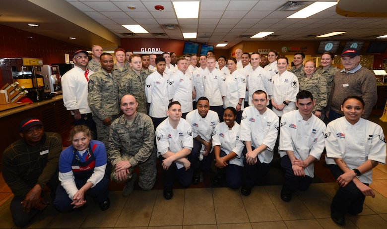 Food services personnel from the 28th Force Support Squadron stand together during a group photo inside the Raider Café at Ellsworth Air Force Base, S.D., Jan. 11, 2018.