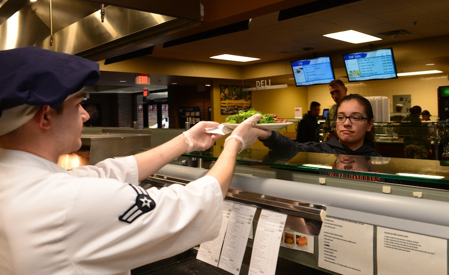 Airman 1st Class Albert Homa, a food services apprentice assigned to the 28th Force Support Squadron, serves a customer inside the Raider Café at Ellsworth Air Force Base, S.D., Jan. 11, 2018.