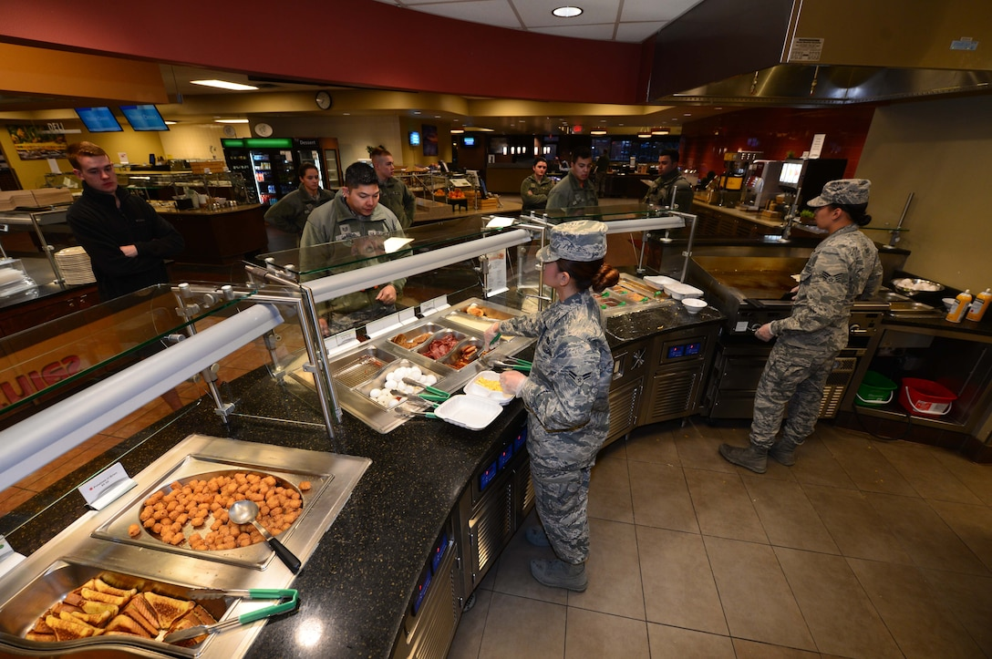 Personnel from the 28th Force Support Squadron serve customers breakfast inside the Raider Café at Ellsworth Air Force Base, S.D., Jan. 12, 2018.