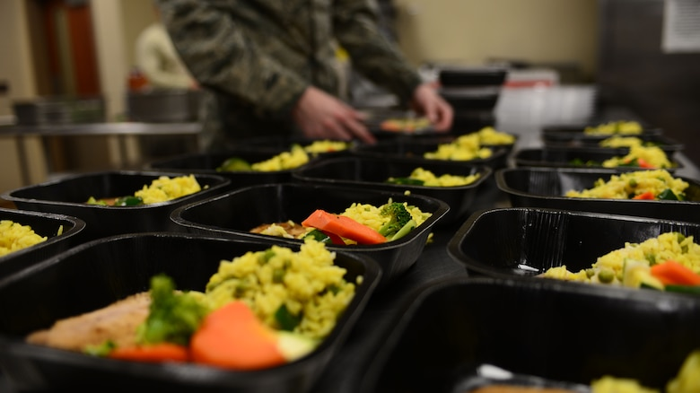 Airman Blake Stroh, a food services apprentice assigned to the 28th Force Support Squadron, prepares to-go boxes inside the Raider Café at Ellsworth Air Force Base, S.D., Jan. 12, 2018.