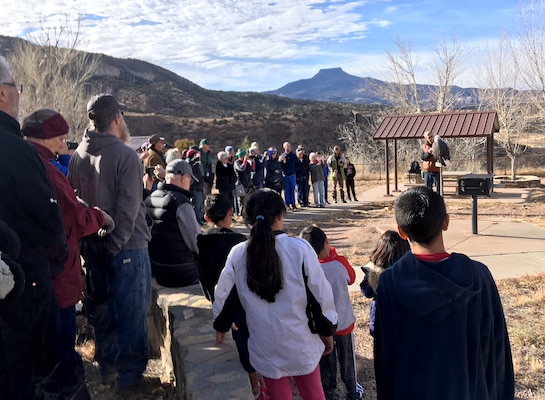 Volunteers for Abiquiu Lake's annual Midwinter Eagle Watch listen to an introductory presentation from The Wildlife Center's representatives, Jan. 6, 2018, before heading out to the lake to count eagles. The Wildlife Center presented their captive bald eagle Maxwell to the group to highlight some of the distinguishing characteristics between golden eagles, and mature and immature bald eagles.