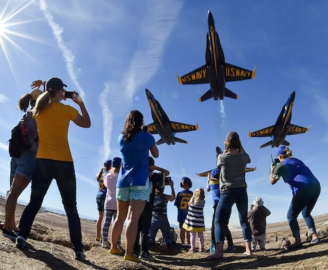 U.S. Navy Blue Angels fly over an excited crowd during a recent airshow.  The Blue Angels are the Navy's premiere aerial demonstration team and perform at air shows around the world.