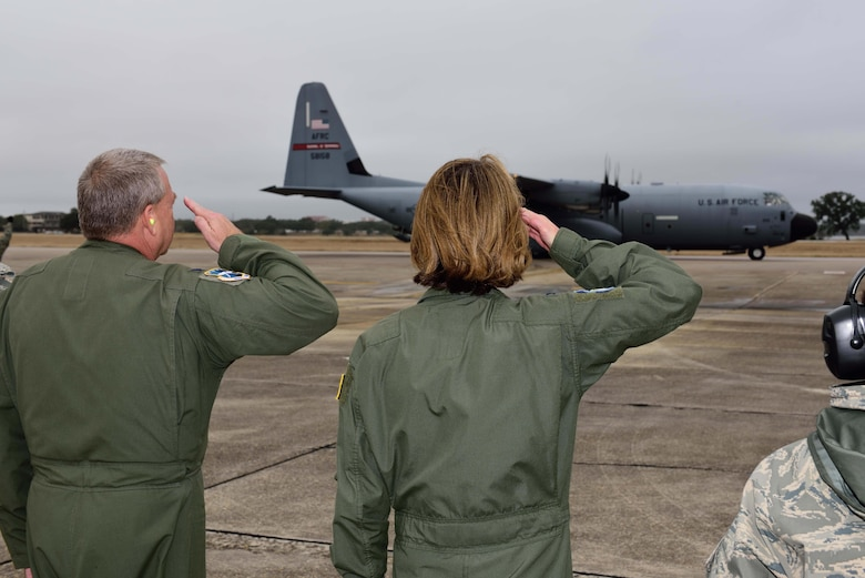 Col. Jennie R. Johnson, 403rd Wing commander, and Col. Robert J. Stanton, 403rd Wing vice commander, salute a C-130J Super Hercules aircraft from the 815th Airlift Squadron as it prepares to take off Jan. 8, 2018, for the squadron's deployment to Southwest Asia. The mission of the 815th AS, a tactical airlift squadron assigned to the 403rd Wing at Keesler Air Force Base, Mississippi, is to recruit, organize and train to deploy, redeploy and employ air and ground forces to any area of the world and provide them with logistical support. (U.S. Air Force photo by Tech. Sgt. Ryan Labadens)
