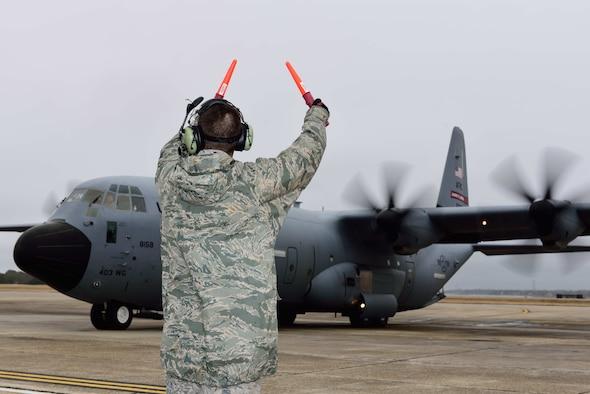 Aircrew members of the 815th Airlift Squadron taxi a C-130J Super Hercules aircraft onto the flight line Jan. 8, 2018, in preparation for takeoff for their deployment to Southwest Asia. Approximately 150 Air Force Reserve Citizen Airmen and several C-130J Super Hercules aircraft from the 403rd Wing have deployed to Southwest Asia in Support of Operations Freedom's Sentinel and Inherent Resolve. (U.S. Air Force photo by Tech. Sgt. Ryan Labadens)