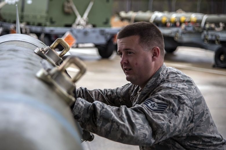 Staff Sgt. John Beeson, 23d Maintenance Squadron (MXS) munitions inspector, pushes a Joint Direct Attack Munition, Jan. 11, 2018, at Moody Air Force Base, Ga. The 23d MXS held a combat munitions class to help acclimate and improve their Airmen's readiness to perform well in a deployed environment.  (U.S. Air Force photo by Airman Eugene Oliver)