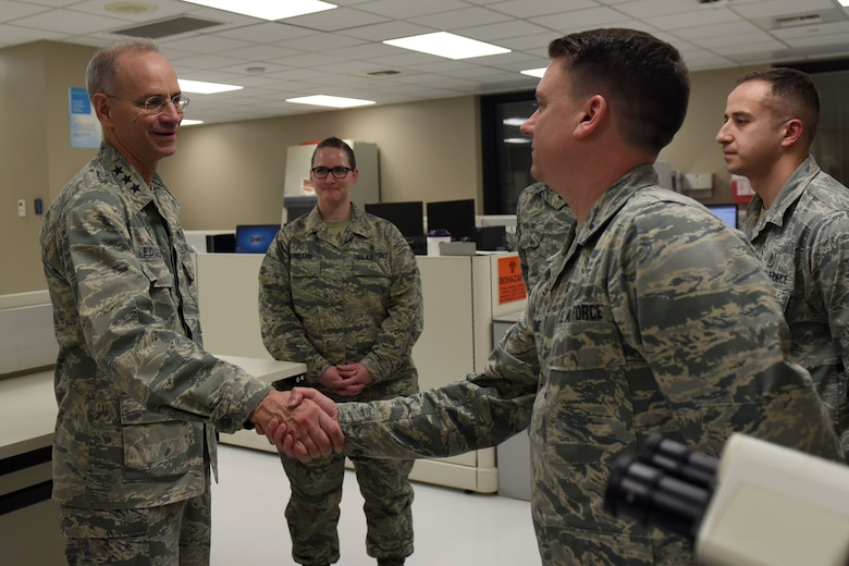 Lt. Gen. Mark Ediger, U.S. Air Force Surgeon General, meets with 92nd Medical Group Airmen during his visit to Fairchild Air Force Base, Washington, Jan. 11, 2018. The 92nd MDG was the first to implement the MHS GENISIS as their primary patient care and record-keeping program. (U.S. Air Force photo/Airman Whitney Laine)