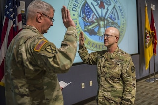 Col. Scott Grammer recites the oath of commission to Maj. Gen. Richard Gallant, commander, Joint Task Force Civil Support, during his promotion ceremony to Colonel , January 11, 2017.