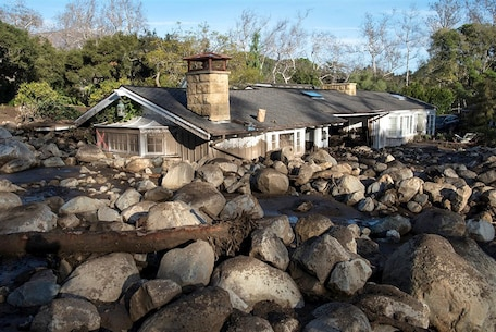 Boulders from a mudslide surround a damaged home on Glen Oaks Road in Montecito, California on Jan. 10