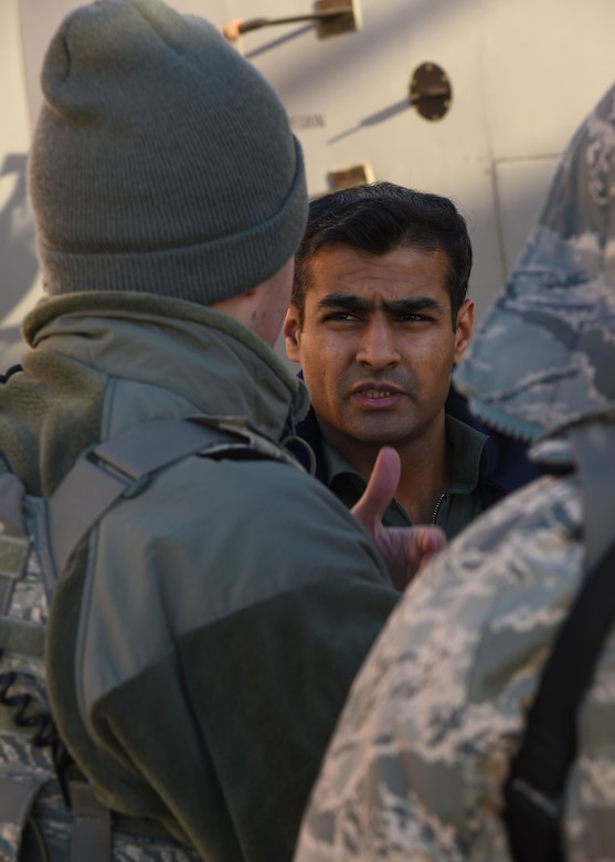 An Indian Air Force crewmember talks with a 319th Security Forces Squadron Airman on the flight line Jan. 13, 2018, at Grand Forks Air Force Base, N.D. (U.S. Air Force photo by Airman 1st Class Elora J. Martinez)