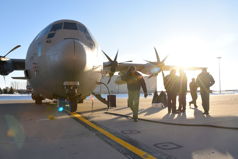 Service members with the Indian Air Force complete routine maintenance on a C-130 Hercules Jan. 13, 2018, after landing at Grand Forks Air Force Base, N.D before heading to McChord AFB, Wash. for exercise Vajra Prahar. (U.S. Air Force photo by Airman 1st Class Elora J. Martinez)