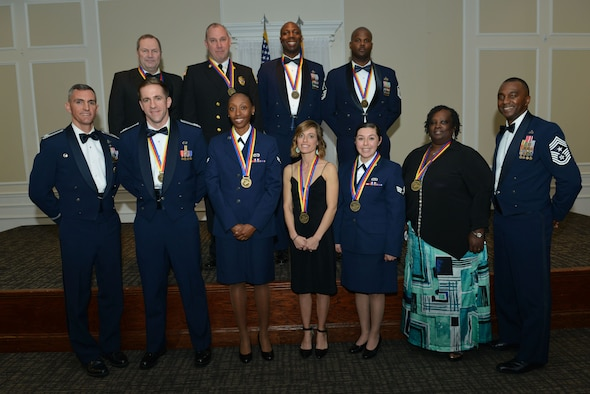 U.S. Airmen assigned to the 20th Fighter Wing stand with wing leadership after being recognized as annual award winners at Shaw Air Force Base, S.C., Jan 27, 2017.