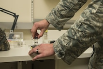 U.S. Air Force Airman 1st Class Jackson Gordon, 20th Aerospace Medicine Squadron bioenvironmental apprentice, places a vial of water into a pocket colorimeter, which measures chlorine, at Shaw Air Force Base, S.C., Jan. 12, 2018.
