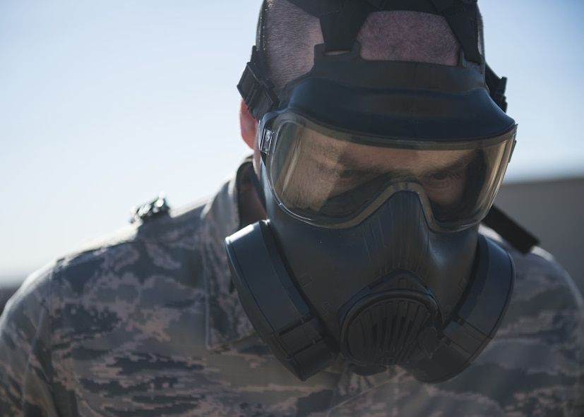 An Airman assigned to Altus Air Force Base, Okla., practices safely removing his Mission Oriented Protective Posture (MOPP) gear, Jan. 10, 2018, at Altus AFB.