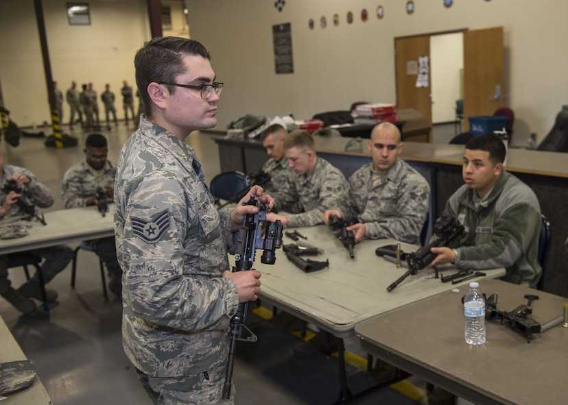 U.S. Air Force Staff Sgt. Cody Reynolds, combat arms instructor assigned to the 97th Security Forces Squadron, instructs Airmen on weapon assembly, Jan. 10, 2018, at Altus Air Force Base, Okla.