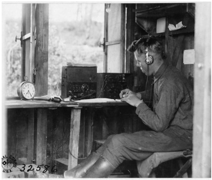 A soldier mans a field intercept station.  These stations collected coded encrypted messages of enemy ground units.