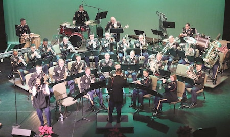 The 1st Infantry Division Band brought the holiday season to the Flint Hills community with a series of free concerts at the historic C.L. Hoover Opera House in Junction City, Kansas, Dec. 15. A culmination of preparations dating back to September, the event consisted of musical arrangements prepared from multiple members of the band.