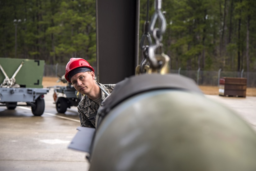 Staff Sgt. Clinton Parkins, 23d Maintenance Squadron (MXS) line delivery supervisor, inspects the alignment of a Joint Direct Attack Munition, Jan. 11, 2018, at Moody Air Force Base, Ga. The 23d MXS held a combat munitions class to help acclimate and improve their Airmen's readiness to perform well in a deployed environment. (U.S. Air Force photo by Airman Eugene Oliver)
