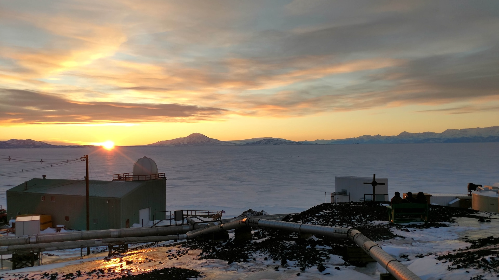 Senior Airman Richard Westra, a geophysical maintenance supervisor with the Air Force Technical Applications Center, Patrick AFB, Fla., snaps a photo of the last sunset of the year at McMurdo Station, Antarctica.  Westra was one of six Airmen from the nuclear treaty monitoring center who traveled to Earth's southernmost point to conduct annual maintenance on AFTAC's seismic equipment.  (U.S. Air Force photo by Senior Airman Richard Westra)