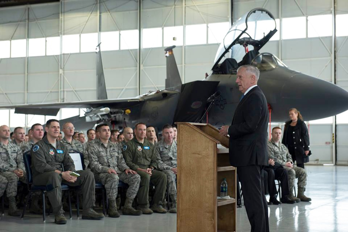 The defense secretary holds a town hall meeting at an air force base.