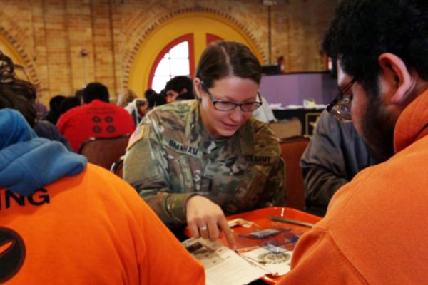 Army Reserve 1st Lt. Katherine Branham of the 416-Theatre Engineering Command assists high school students in STEM programs with a circuit building activity workshop as part of the Go Army Experience Ten80 STEM workshop in San Antonio, Texas, Jan. 5, 2018. Army photos by Sgt. Ian Valley
