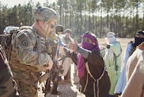 Capt. Christopher Young, a combat advisor team leader for the 2nd Battalion, 1st Security Force Assistance Brigade, engages with a local civilian role player during the unit's rotation at the Joint Readiness Training Center at Fort Polk, La., Jan. 15, 2018. The JRTC rotation was conducted in order to prepare the newly formed 1st SFAB for an upcoming deployment to Afghanistan in the spring of 2018. SFABs provide combat advising capability while enabling brigade combat teams to prepare for decisive action, improving readiness of the Army and its partners. (U.S. Army photo by Staff Sgt. Sierra A. Melendez, 50th Public Affairs Detachment, 3rd Infantry Division Public Affairs)